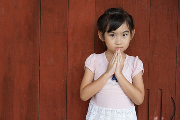 Asian child cute girl Hello salute