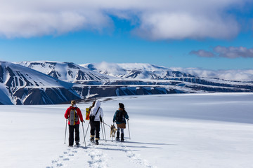 Snowshoeing with a husky in Svalbard