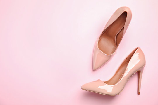 Pair of beautiful shoes and space for text on color background, top view