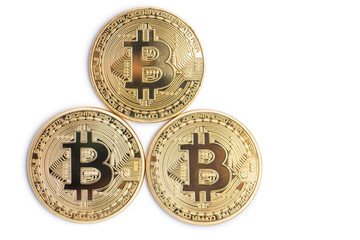 Golden bitcoin isolated on white