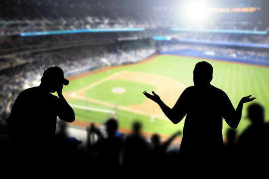 Sad baseball fans in stadium. Disappointed, angry and upset crowd in ballpark. Favourite team lost game. Devastated audience in live sport event. Angry silhouette people watching ballgame.