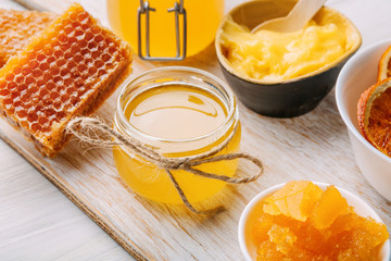 Different varieties of sweet golden fresh honey