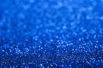 Shiny blue abstract christmas background. Blue glitter.