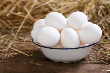 bowl of eggs on a wooden table