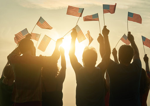 Silhouette of usa family against sunshine background. Group of patriotic people, back rear view.