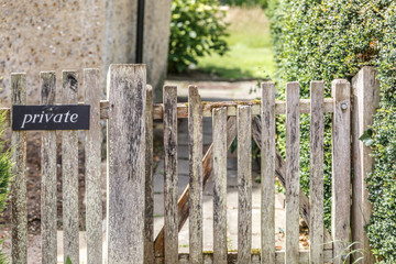 Entrance with a rustic wooden fence of a rural house in England