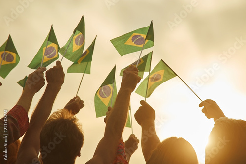 Hands holding brazil flags  Together - we are force, brazilian