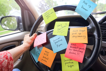 Steering wheel covered in notes as a reminder of errands to do Wall mural