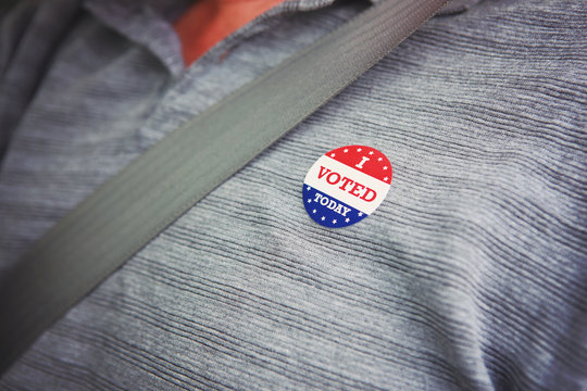 I voted today sticker on a mans shirt after voting