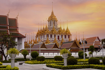 Wall Mural - Loha Prasart at Wat Ratchanatda while beautiful sunset sky in Bangkok, Thailand.
