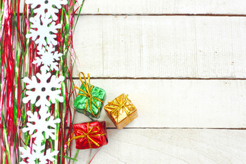 New Year, Christmas background, tinsel, garland snowflakes, three gift boxes