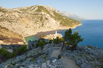 View of the shores of the Adriatic Sea and the Biokovo Mountains in the background in Croatia