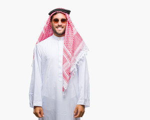 Young handsome man wearing keffiyeh over isolated background with a happy and cool smile on face. Lucky person.