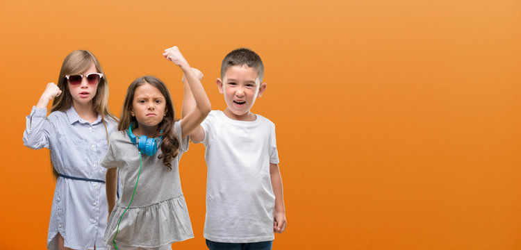 Group of boy and girls kids over orange background annoyed and frustrated shouting with anger, crazy and yelling with raised hand, anger concept
