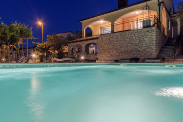 Holiday home with swiiming pool at night