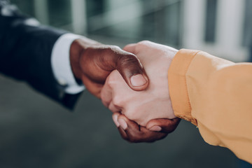 Strong agreement. A close up of handshake with gratitude. A man and woman shaking hands in acknowledgement of partnership.