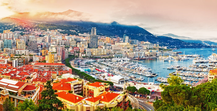 Principality of Monaco. Picturesque panoramic view on Monaco on sunset hour. View on apartment building, casino, port with luxury yachts. Monaco is popular travel destination for gambling.