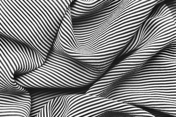 Elegant black and white striped silk with waves, background texture