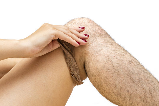 girl takes off pantyhose with her hair. The concept of depilation. Difference before and after shave effect