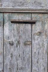 mailbox on old wooden door