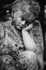 Vintage image of a sad angel  (religion, faith, death, resurrection, eternity concept)