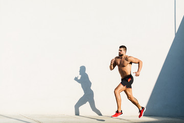 Athletic build man running outdoors
