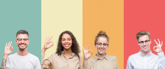 Collage of a group of people isolated over colorful background smiling positive doing ok sign with hand and fingers. Successful expression.