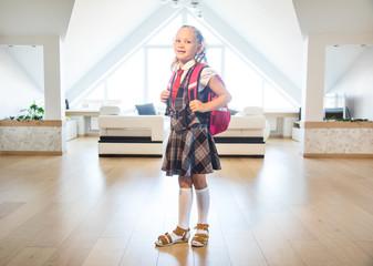 little schoolgirl with school bag