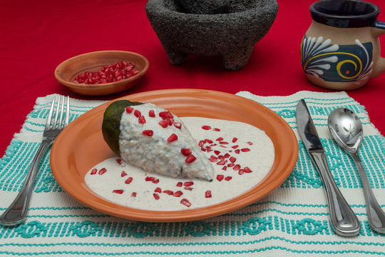 Stay home and prepare your own meals, Chile en Nogada is a traditional mexican dish. Poblano pepper stuffed with ground meat, covered in walnut cream and pomgrenade seeds.