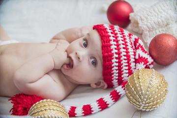 baby in Christmas cap