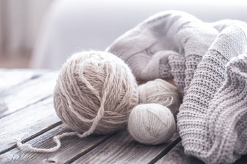 home hobbies, cozy knitted sweaters, wooden background