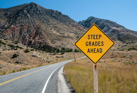 Steep Grades Warning Sign:  A sign warns of a steep climb ahead on a road leading into the Big Horn Mountains of northeastern Wyoming