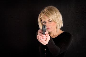 Blonde Woman Holding Gun