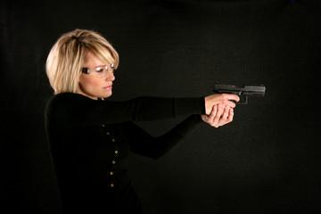 Blonde Woman Shooting a Gun