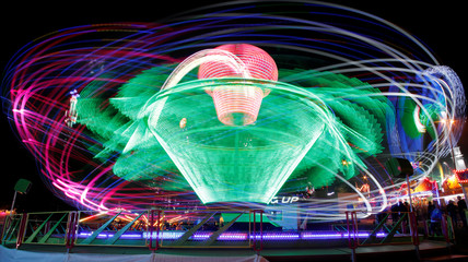 A long exposure shows carousels at the traditional Knabenschiessen public festival in Zurich