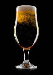 Cold glass of lager beer with foam and bubbles