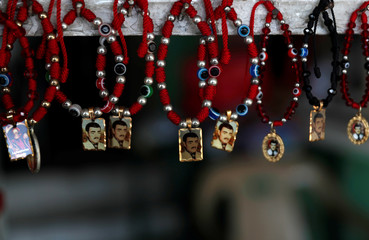 """Souvenirs of """"Malverde"""" are pictured in a store beside the """"Saint Jesus Malverde"""" chapel in Culiacan, in Mexico's state of Sinaloa"""