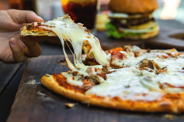 Delicious pizza with mozzarella cheese, minced meat and bacon