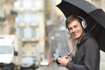 Teen listening to music looking at you