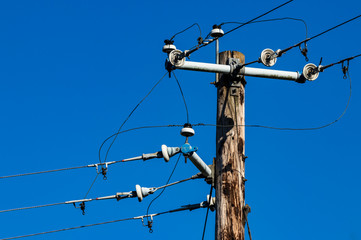 Old power pole with insulators and wires
