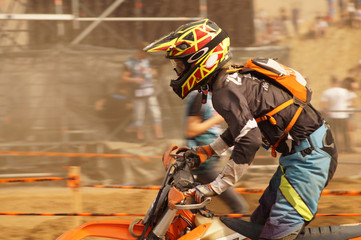 Silhouette of a participant in motorcycle enduro competitions.