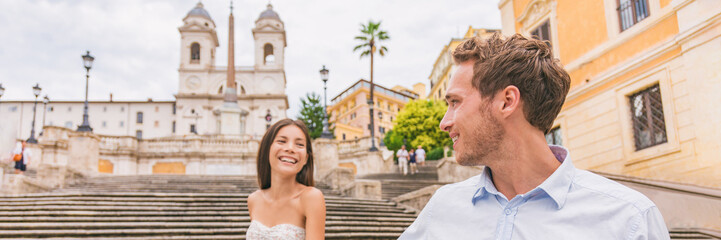 Wall Mural - Happy couple honeymoon Europe travel in Rome, Italy on Spanish Steps. Young interracial man and elegant Asian woman walking on landmark tourist attraction on romance holiday vacation banner.