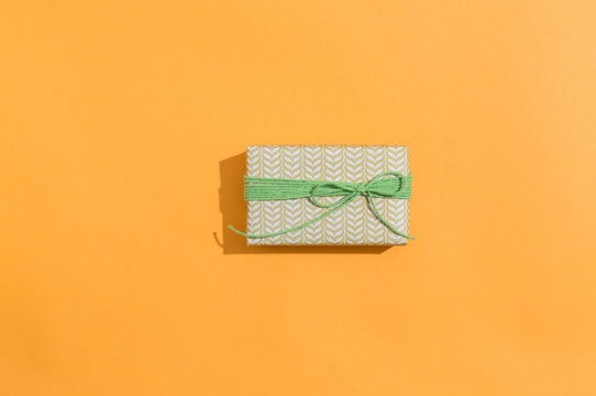 A gift box on a orange background