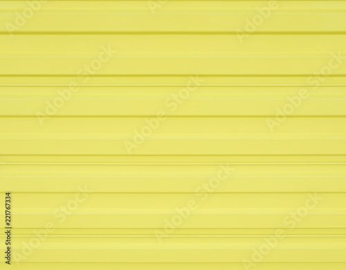 Yellow corrugated metal fence texture