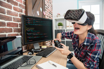 wearing virtual reality goggles and playing game
