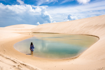 Lonaly woman at amazing landscape of Lencois Maranhenses at north of Brazil