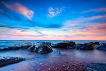 Beautiful Sunset and blue sky at rocky Brighton Beach, Duluth, Minnesota