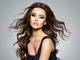 Face of a beautiful  woman with long brown  hair