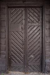 Wooden door with ancient patten