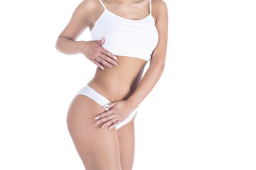 A young female body in her underwear on a white background.